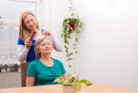 caregiver combing her patient's hair